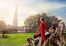 Woman pointing at Qutub Minar Royalty Free Stock Photos