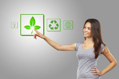Woman pointing recycle symbol Stock Images