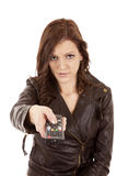 Woman pointing remote mad Royalty Free Stock Image