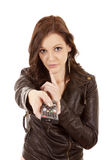 Woman pointing remote quiet Stock Image