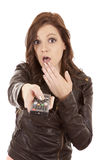 Woman pointing remote shock Royalty Free Stock Photos