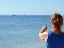 Woman pointing at rescue boats, Sanibel, Florida Stock Photo