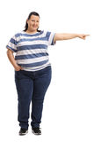 Woman pointing right and looking at the camera Stock Images