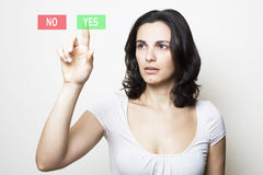 Woman pointing with sad face at YES Royalty Free Stock Photos