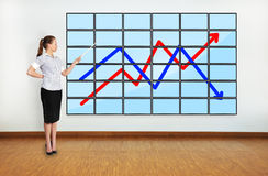 Woman pointing at scheme Stock Image