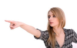 Woman pointing or showing direction. Closeup portrait of beautiful young woman pointing her finger at something in a distance or showing direction Stock Photos