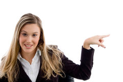 Woman pointing sideways Stock Photo