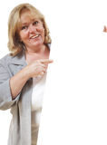 Woman pointing at sign Stock Photo