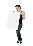 Woman pointing at sign. Attractive young girl pointing at a blank sign Royalty Free Stock Photography