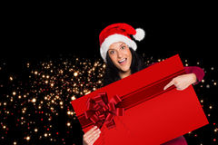 Woman pointing at sign with red christmas ribbon Stock Photography