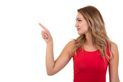 Woman pointing at sign. Young beautiful sexy woman showing copy space on empty blank sign or gift card. Stock Photo