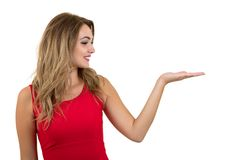 Woman pointing at sign. Young beautiful sexy woman showing copy space on empty blank sign or gift card. Stock Photography
