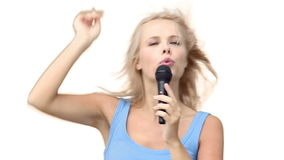 Woman pointing while singing with a microphone stock video footage