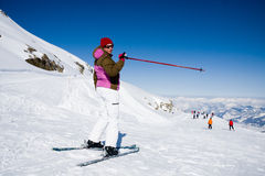 Woman pointing ski slope Stock Photo