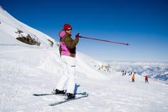 Woman pointing ski slope stock photo