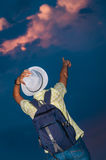 Woman pointing sky sunset clouds copy space Stock Photos