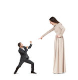 Woman pointing at small man. Emotional screaming women pointing at small man. isolated on white background Stock Photo