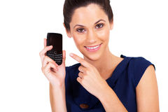 Woman pointing at smart phone Stock Photography