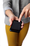 Woman pointing at smartphone screen Royalty Free Stock Photos