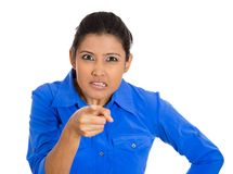 Woman pointing at someone as if to say you did something wrong. Closeup portrait of young pretty unhappy, serious woman pointing at someone as if to say you did Royalty Free Stock Photography