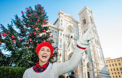 Woman pointing on something near christmas tree in Florence Stock Photos