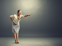 Woman pointing at something and screaming. Excited young woman pointing at something and screaming Royalty Free Stock Images