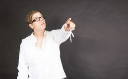 Woman pointing at something Royalty Free Stock Photos