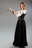 Woman pointing steampunk gun Stock Photography