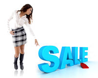 Woman pointing at three dimensional sale text. The woman pointing at three dimensional sale text Royalty Free Stock Image