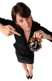 Woman Pointing to Alarm Clock royalty free stock images