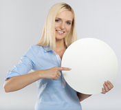Woman pointing to a blank board Royalty Free Stock Photos