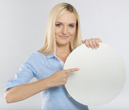 Woman pointing to a blank board Stock Images