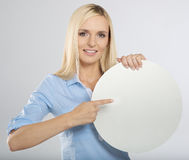 Woman pointing to a blank board Royalty Free Stock Image