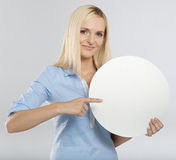 Woman pointing to a blank board Royalty Free Stock Photography