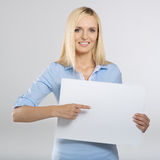 Woman pointing to a board Stock Images