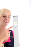 Woman pointing to the bubble in a spirit level Royalty Free Stock Photos