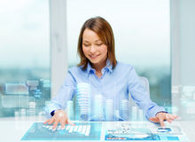 Woman pointing to buttons on virtual screen Royalty Free Stock Photography