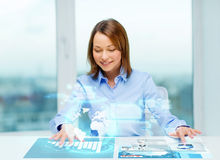 Woman pointing to buttons on virtual screen Royalty Free Stock Photo