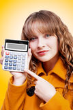 Woman pointing to calculator keypad Stock Images