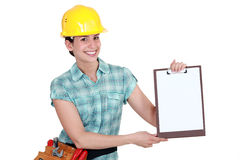Woman pointing to clip-board Stock Image