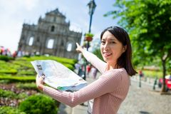 Woman pointing to the destination in Macao Royalty Free Stock Photography