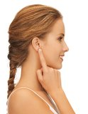 Woman pointing to ear Stock Image