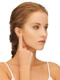 Woman pointing to ear Royalty Free Stock Photography