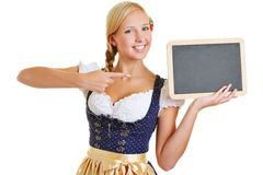 Woman pointing to empty blackboard stock images