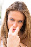 Woman pointing to the eyes Royalty Free Stock Photography