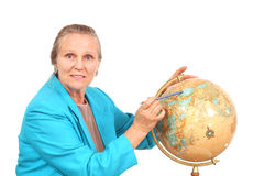 Woman pointing to globe Royalty Free Stock Images