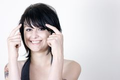 Woman pointing to head Royalty Free Stock Image