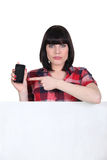 Woman pointing to her mobile Royalty Free Stock Photo