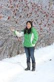 Woman pointing to Ice on Sumac Bush Royalty Free Stock Image