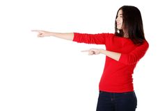 Woman pointing to the left Stock Images
